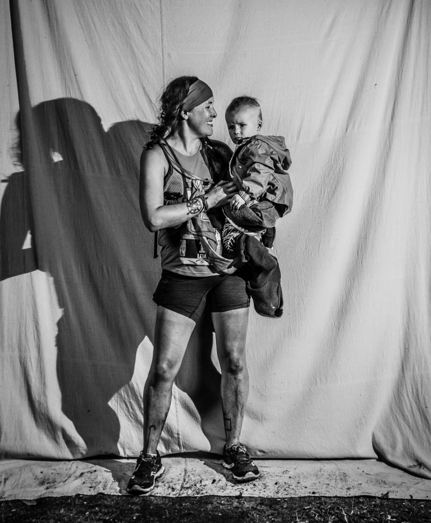 Leia (@leia_anderson) finds ways to share the trails with her son, which makes seeing his face (and her husband's) at the finish line that much sweeter. (photo cred: @mile90photo)